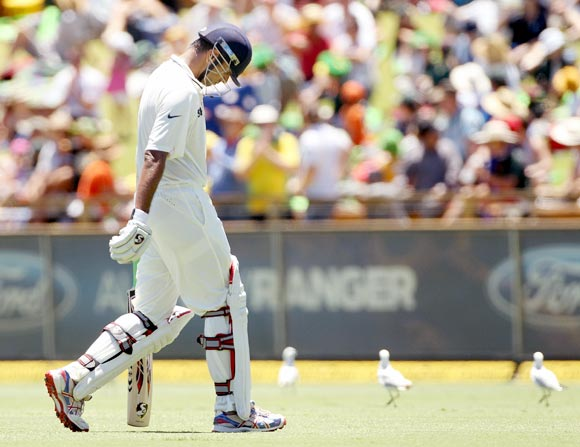 Rahul Dravid walks back after his dismissal
