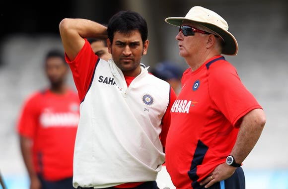 Mahendra Singh Dhoni (left) chats to coach Duncan Fletcher
