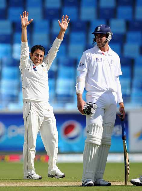 Saeed Ajmal celebrates after picking up a wicket against England in Dubai