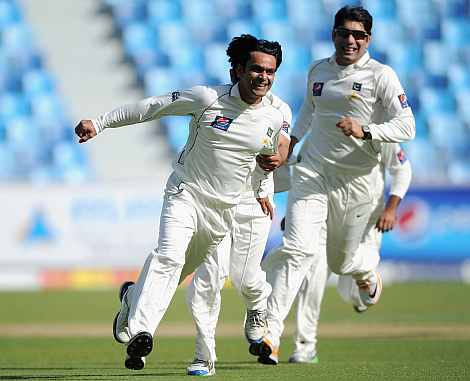Mohammaed Hafeez celebrates after picking up a wicket
