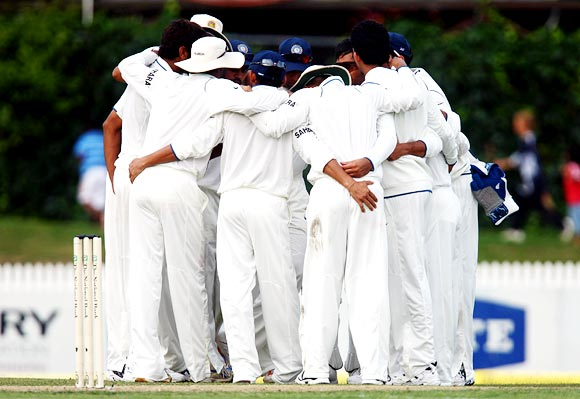 The Indian cricket team in a huddle