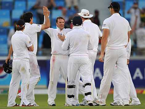 Graeme Swann celebrates after picking up the wicket of Misbah ul Haq