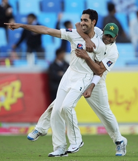 Umar Gul celebrates with Abdur Rehman after dismissing Jonathan Trott