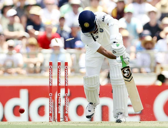 Rahul Dravid is bowled by Peter Siddle