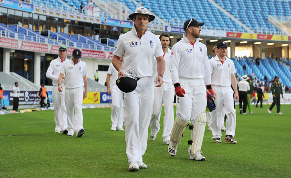 Captain Andrew Strauss of England leads his team from the field after defeat in the first Test match between Pakistan and England at The Dubai International Cricket Stadium