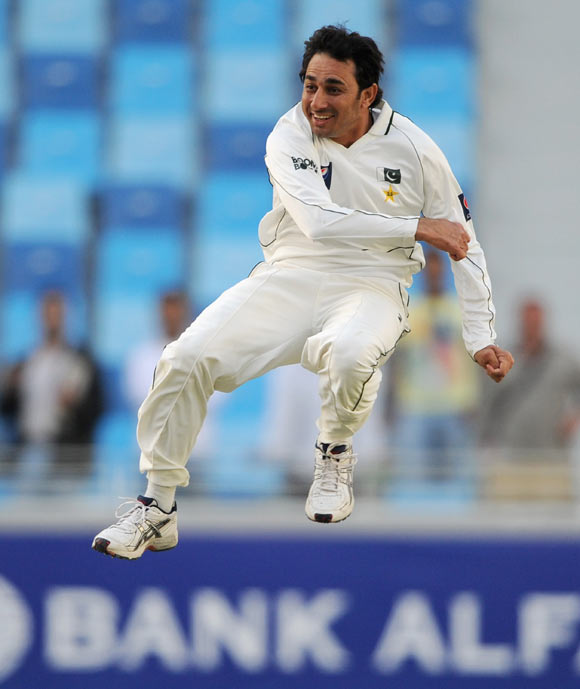 Saeed Ajmal of Pakistan celebrates dismissing Graeme Swann of England and taking his 10th wicket of the match during the first Test match