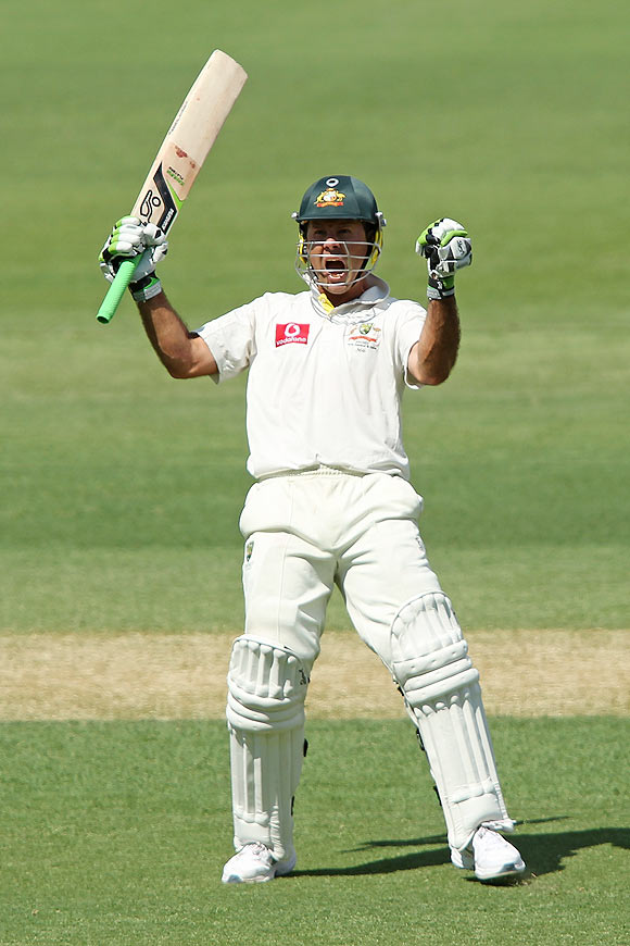 Ricky Ponting celebrates after getting a century on Monday