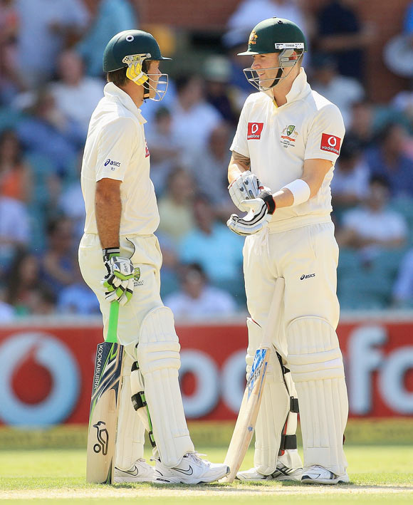 Ponting and Clarke talk during their innings on Monday