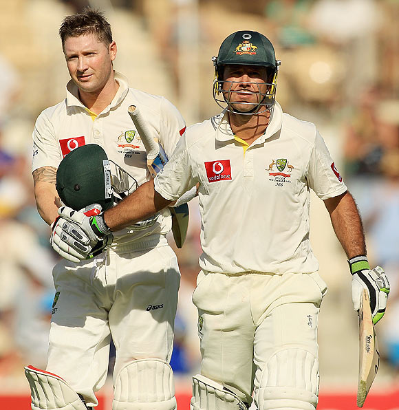 Ricky Ponting (right) and Michael Clarke leave the field at the end of the first day's play on Monday