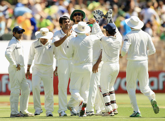 Zaheer Khan celebrates with team mates after taking the wicket of David Warner during day one of the fourth Test