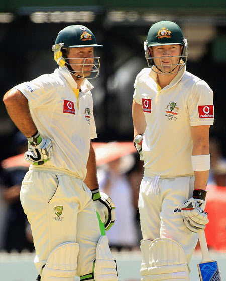 Michael Clarke (R) and Ricky Ponting talk between overs during their 386-run partnership during day two of the fourth Test