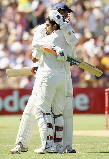 Virat Kohli celebrates his century with teammate Ishant Sharma