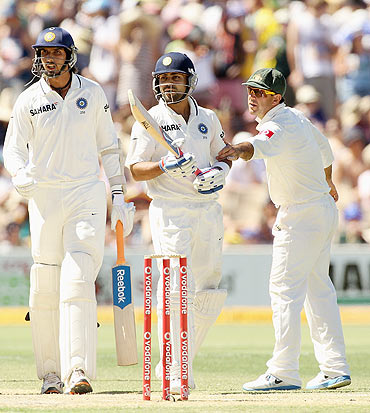Ricky Ponting restrains Virat Kohli as he argues with Australian players