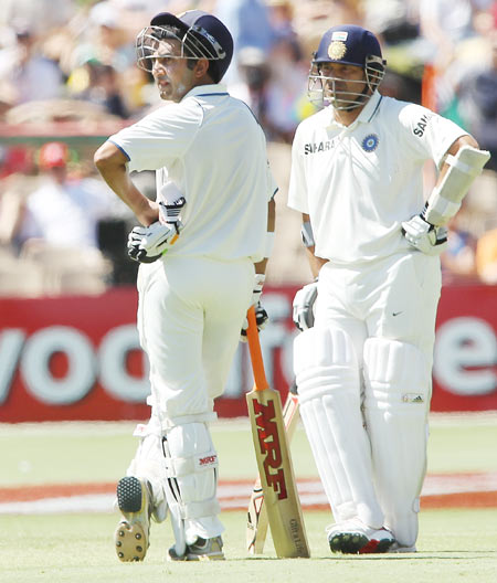 Gautam Gambhir (L) and Sachin Tendulkar (R) of India wait for a replay to determine if Tendulkar is out or not (he as given out) during day three of the Fourth Test