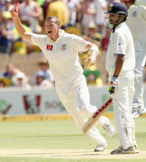 Peter Siddle of Australia celebrates the wicket of Gautam Gambhir of India during day three of the Fourth Test Match between Australia and India at Adelaide Oval