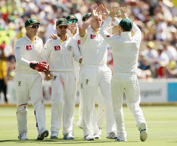 Peter Siddle of Australia celebrates the wicket of Sachin Tendulkar of India with team mates during day three of the Fourth Test
