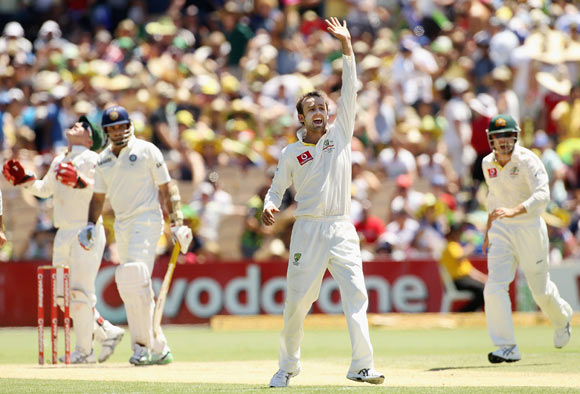 Nathan Lyon of Australia appeals successfully for the wicket of VVS Laxman of India during day three of the Fourth Test Match between Australia and India at Adelaide