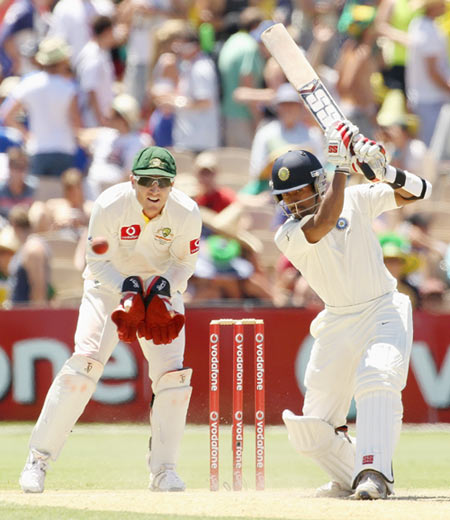 Wriddhiman Saha of India hits out with Brad Haddin of Australia looking on during day three of the Fourth Test