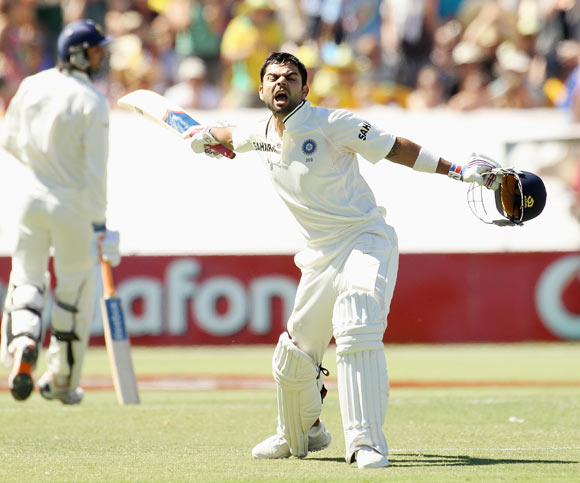 Virat Kohli of India celebrates his century during day three of the Fourth Test Match between Australia and India at Adelaide Oval