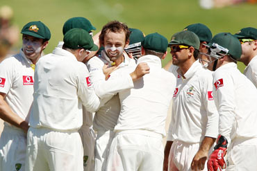 Nathan Lyon celebrates with teammates