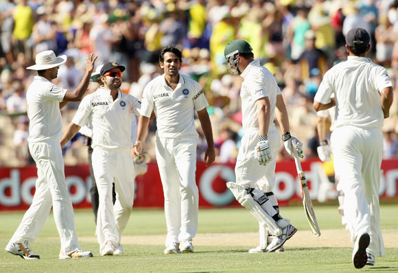 Shaun Marsh eaves the field after being dismissed by Zaheer Khan on day three