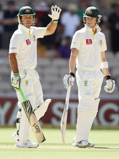 Michael Clarke (R) and Ricky Ponting (L) of Australia during day four of the Fourth Test Match between Australia and India at Adelaide Oval