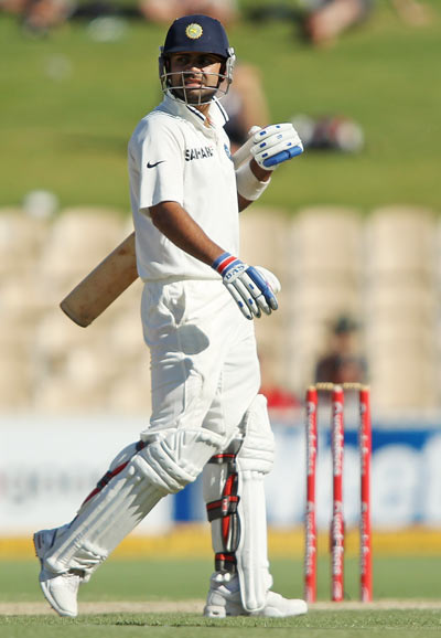Virat Kohli leaves the field after being run-out