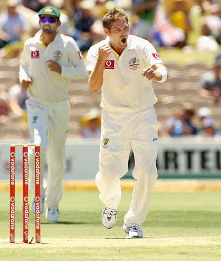 Ryan Harris celebrates after taking the wicket of Gautam Gambhir