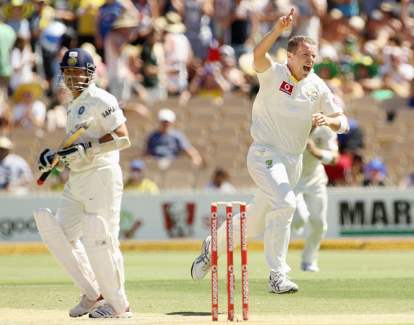 Peter Siddle of Australia celebrates the wicket of Sachin Tendulkar of India during day three of the Fourth Test Match between Australia and India at Adelaide Oval
