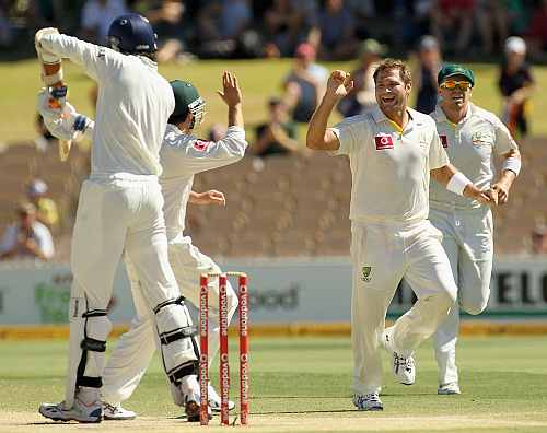 Ryan Harris celebrates after picking up the wicket of Ishant Sharma on Day Five of fourth Test