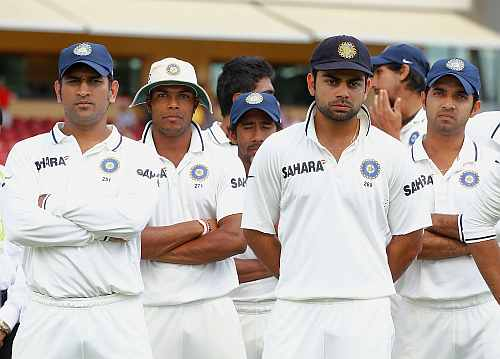 MS Dhoni and teammates look on after losing the fourth Test in Adelaide