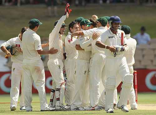 Australian players celebrate after getting the wicket of Umesh Yadav