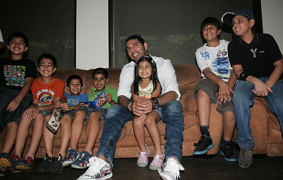 Cancer survivor Yuvraj Singh plays with kids during the launch of  YouWeCan, a cancer-awareness programme in New Delhi
