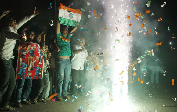 Fans in Allahabad celebrate India's win over Pakistan in the Asia Cup