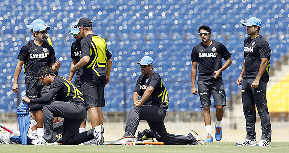 India's Mahendra Singh Dhoni (centre) and teammates attend at a practice session ahead of their first ODI against Sri Lanka in Hambantota