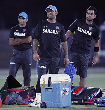 India's captain Mahendra Singh Dhoni (centre) and vice-captain Virat Kohli (right) at a practice session ahead of their first ODI against Sri Lanka in Hambantota