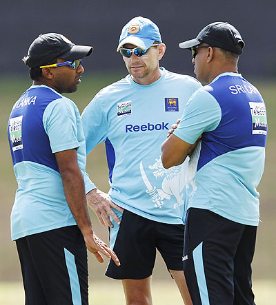 Sri Lanka's captain Mahela Jayawardene (left) talks with coach Graham Ford (centre) during a practice session on Friday
