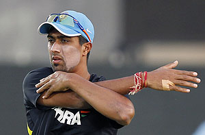 India's Rahul Sharma stretches during a practice session ahead of the first ODI against Sri Lanka in Hambantota