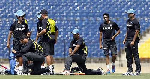 Indian players warm up during a practice session ahead of their first One Day International match against Sri Lanka in Hambantota