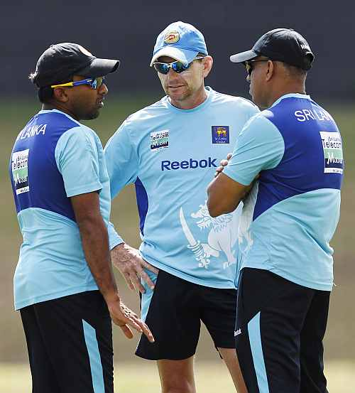 Sri Lanka's captain Mahela Jayawardene talks with coach Graham Ford during a practice session