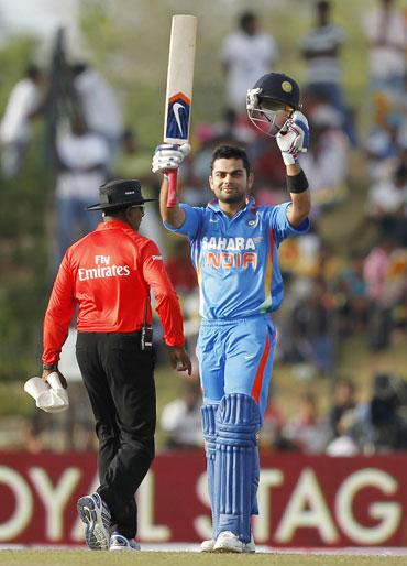 Virat Kohli celebrates after scoring his century on Saturday
