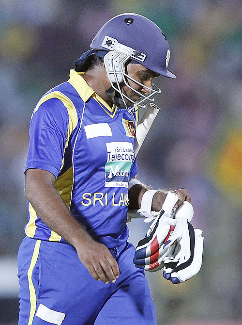 Sri Lanka's captain Mahela Jayawardene walks off the field after his dismissal