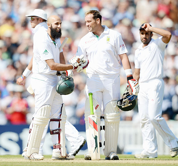 Hashim Amla of South Africa celebrates with Jacques Kallis