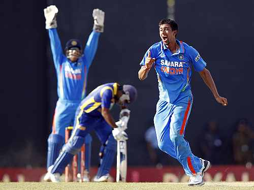 Rahul Sharma celebrates after picking the wicket of Mahela Jayawardene