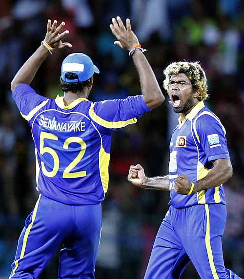 Lasith Malinga celebrates after picking up the wicket of MS Dhoni