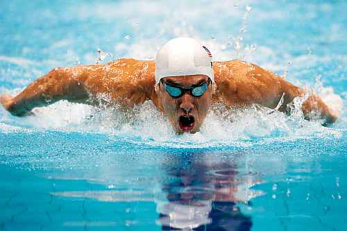 Michael Phelps of the United States competes in heat 5 of the Men's 200m Butterfly on Day 3 of the London 2012 Olympic Games
