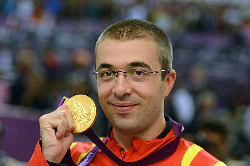 Gold medallist Alin George Moldoveanu of Romania poses with the gold medal won in the Men's 10m Air Rifle Shooting