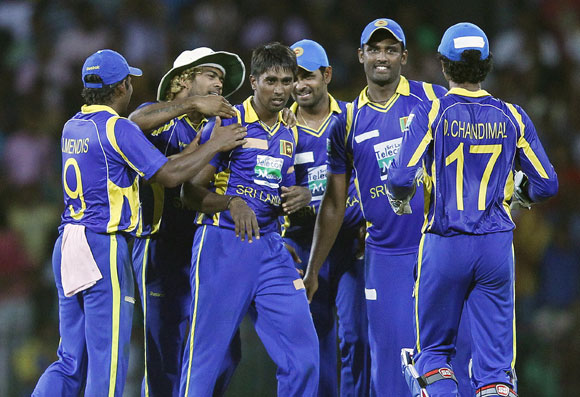 Sri Lanka's Nuwan Pradeep (3rd L) celebrates with his teammates after taking the wicket of India's Rohit Sharma