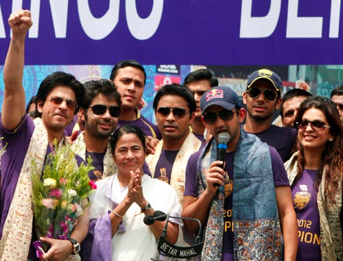 Kolkata Knight Riders players celebrate winning the IPL with West Bengal chief minister Mamata Banerjee in Kolkata