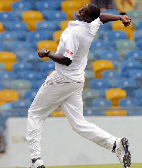 Jason Holder celebrates a wicket